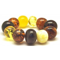 Massive multicolor baroque beads Baltic amber bracelet 71 g .