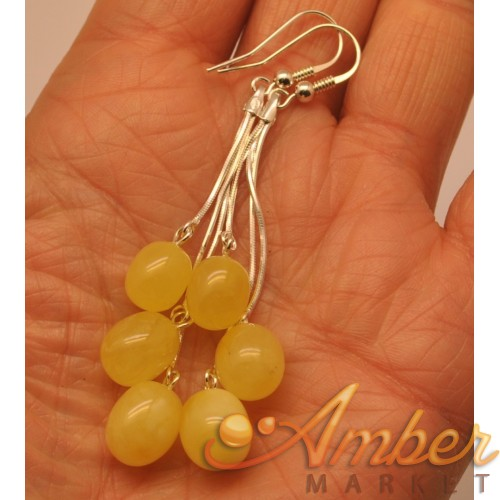 Long olive shape amber earrings