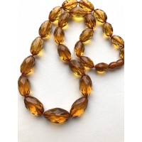 Faceted olive shape amber necklace
