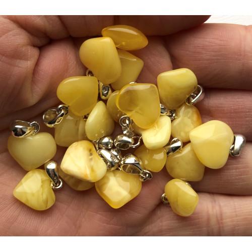 20 Yellow amber heart pendants