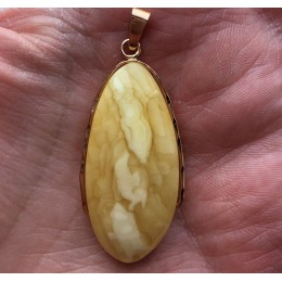 Amber pendant with 14 carat gold