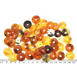 Lot of 50 unpolished Baltic amber amulet pendants