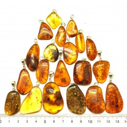 Lot of 20 free form Baltic amber pendants