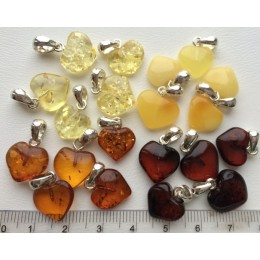 20 pcs. Baltic amber heart shape pendants