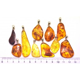 Lot of 10 free form Baltic amber pendants