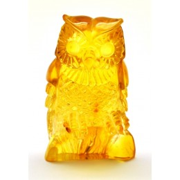 Hand carved Baltic amber figurine of owl with insect