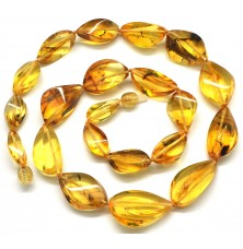 Faceted Baltic amber necklace with insects