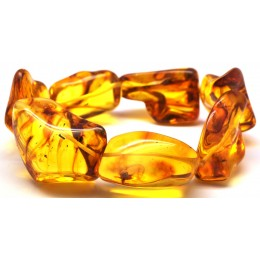 Natural shapes Baltic amber bracelet with insects