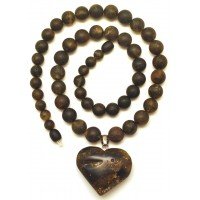 Raw healing round beads Baltic amber necklace with heart pendant