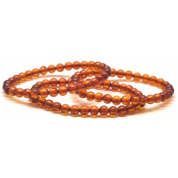 Lot of 3 round beads Baltic amber bracelets 5,8 mm.