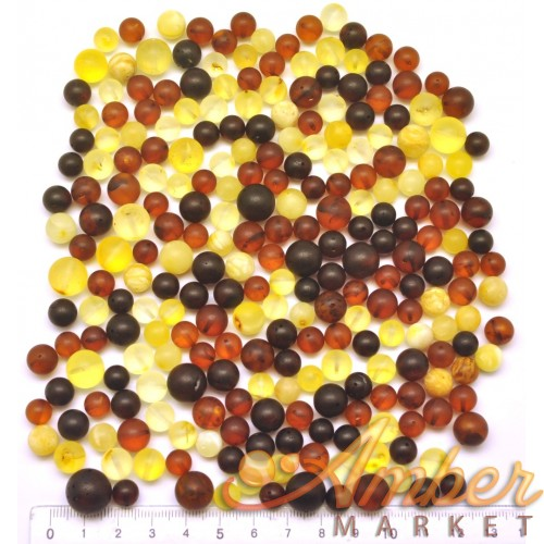 100 g Loose round unpolished amber beads 7 - 13 mm