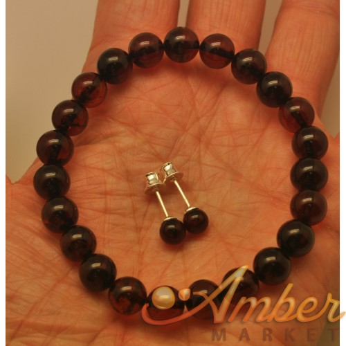 Round beads cherry Baltic amber set of bracelet and earrings.