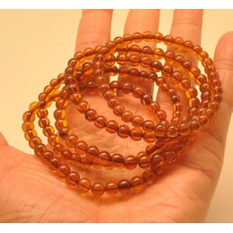 Lot of 5 round beads amber bracelets  5 - 6 mm.