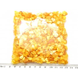 Yellow drilled Baltic amber nuggets 100 g .