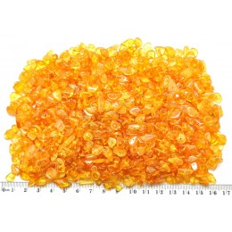 Honey drilled Baltic amber nuggets 100 g .
