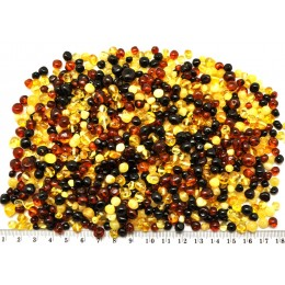 Drilled Baltic amber baroque beads 100 g .