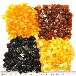 Drilled Baltic amber nuggets 100 g .