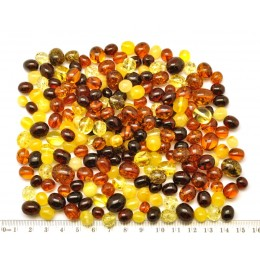 Loose drilled Baltic amber olive shape beads 100 g .